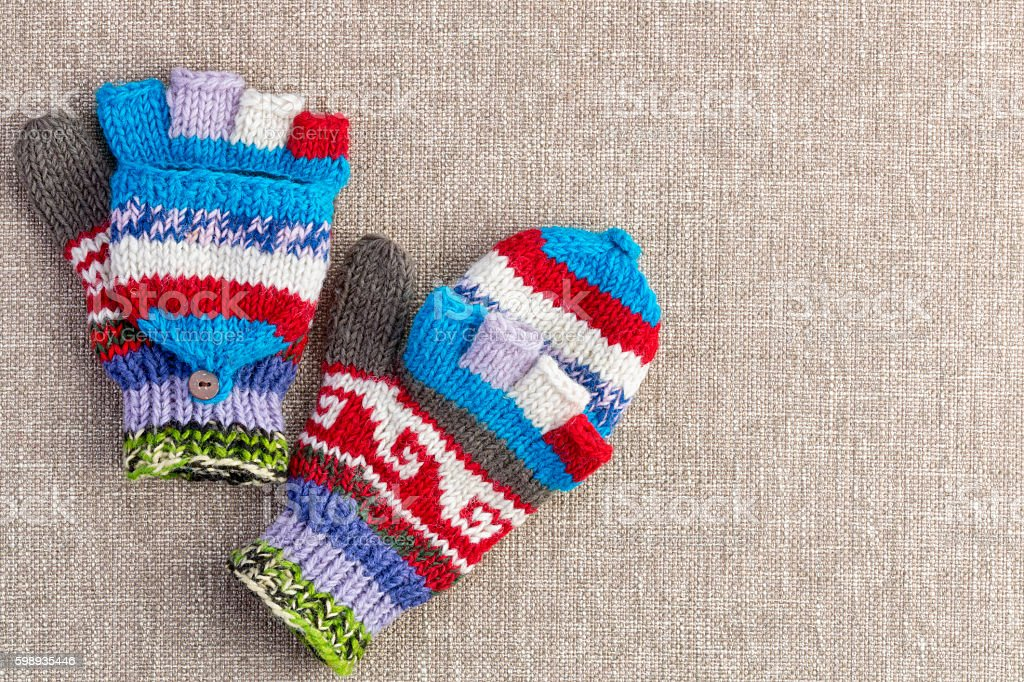 Colorful knitted convertible fingerless gloves stock photo