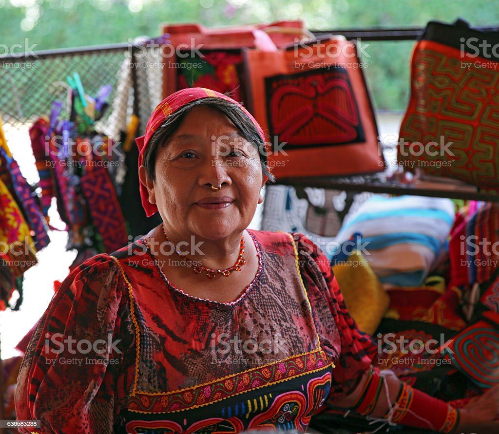 Colorful Kuna Artist Selling Her Tribal Art and Crafts stock photo