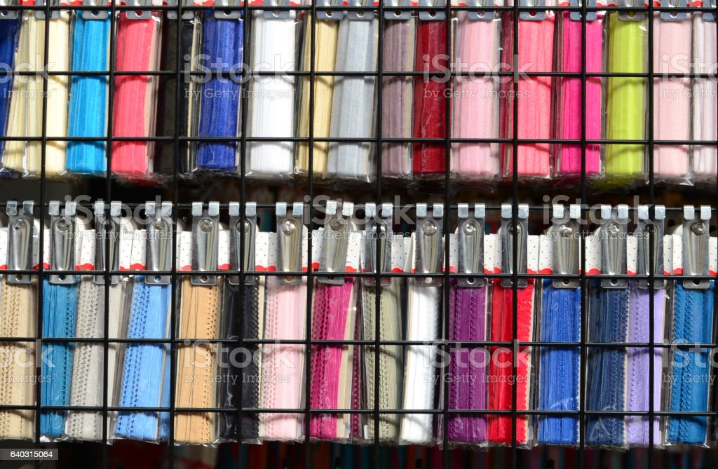 Colorful laces hanging on shelves stock photo