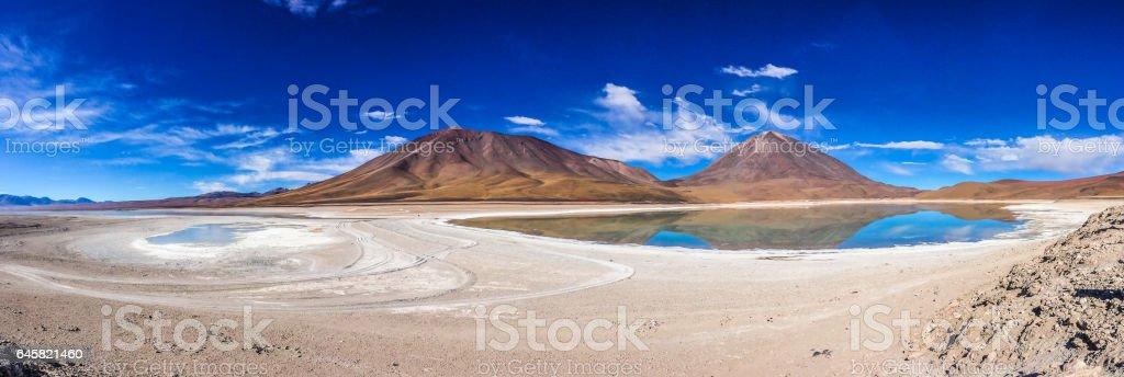 Colorful lagoon at the Salar de Uyuni in Bolivia stock photo