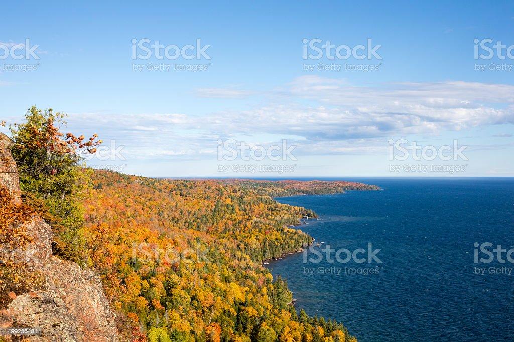 Colorful Lake Superior Shoreline with Blue Sky stock photo