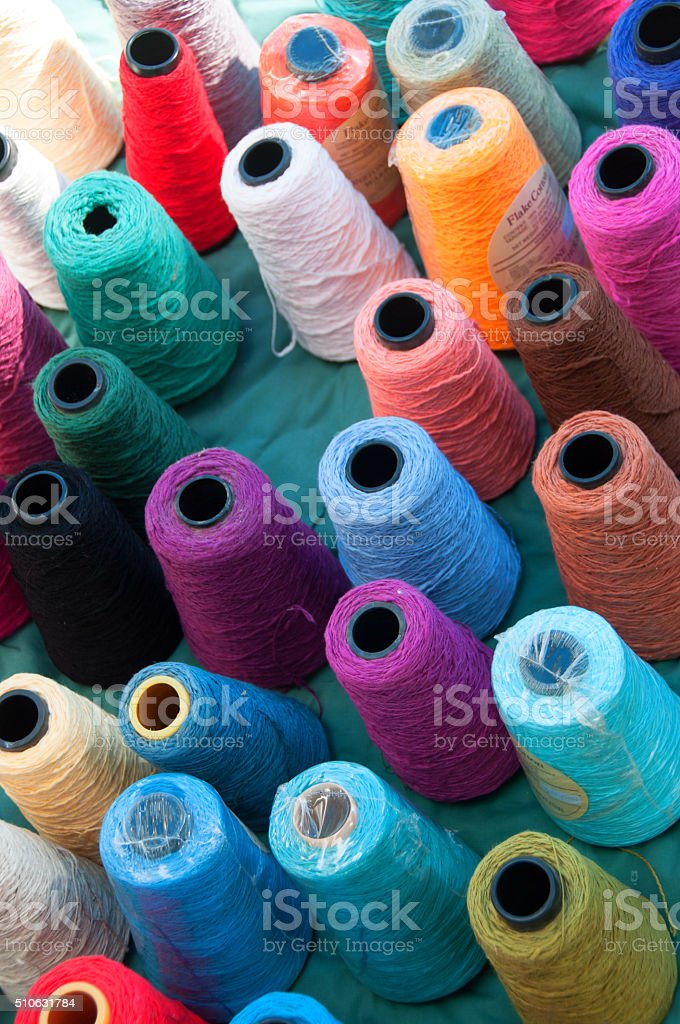 Colorful Large Spools of Weavers'  Thread From Above stock photo