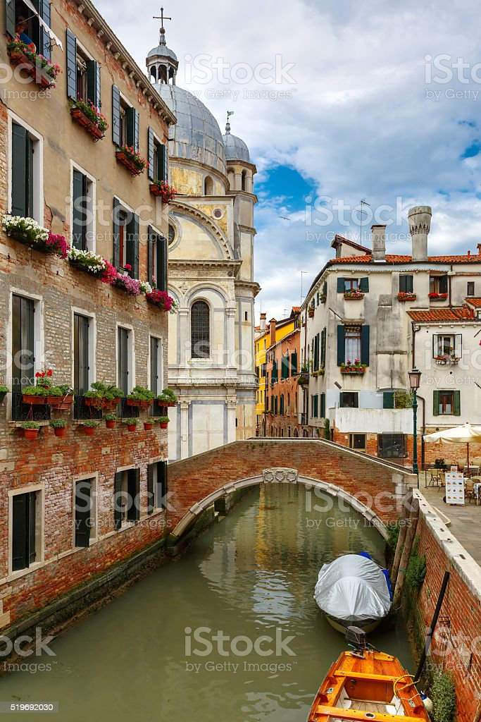 Colorful lateral canal and bridge in Venice, Italy stock photo
