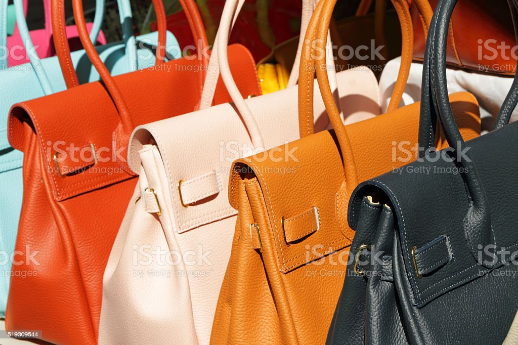 colorful leather handbags for sale stock photo