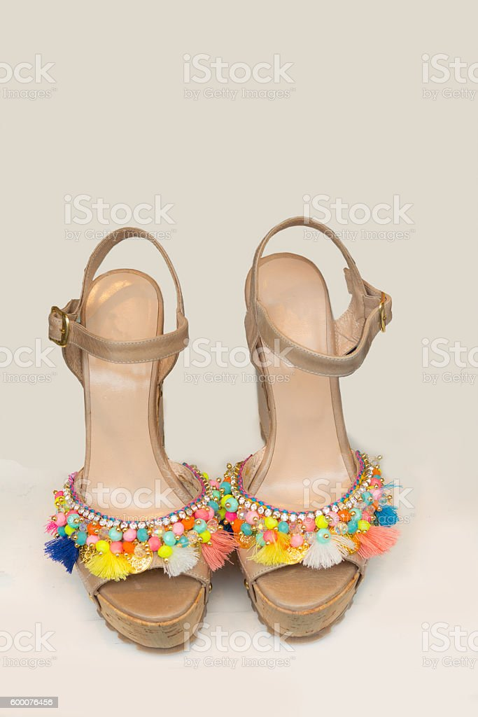 Colorful  leather wedge sandals with beads and tassels stock photo