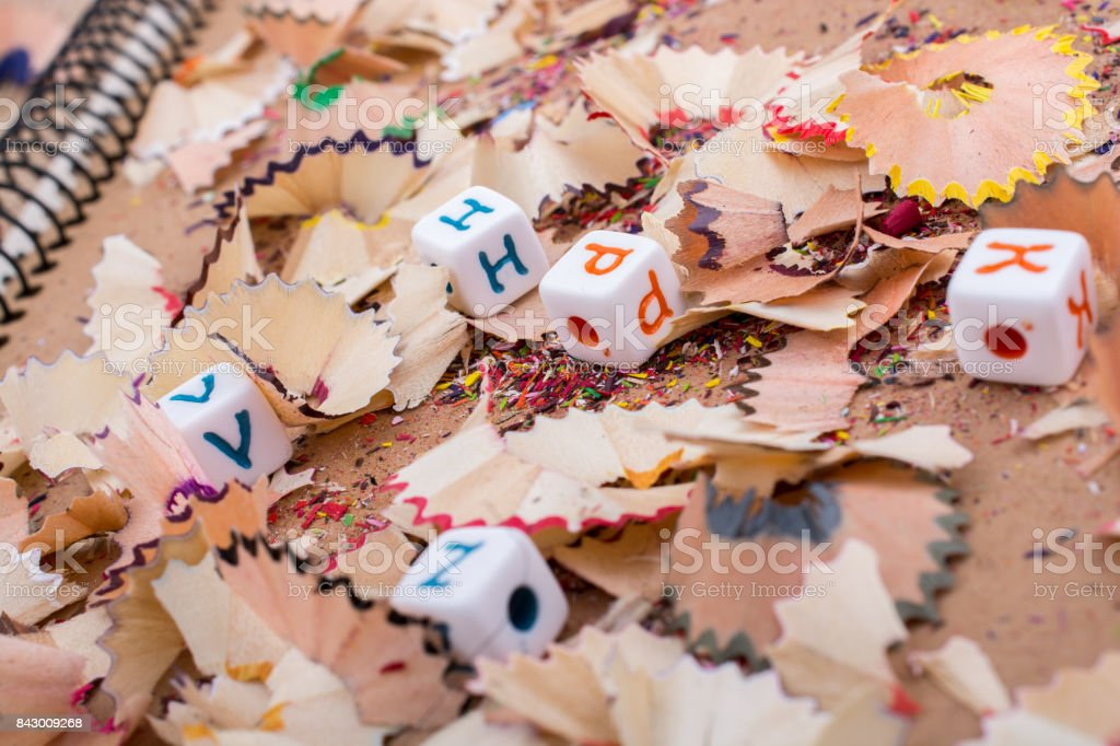Colorful letter cubes on pencil trash stock photo