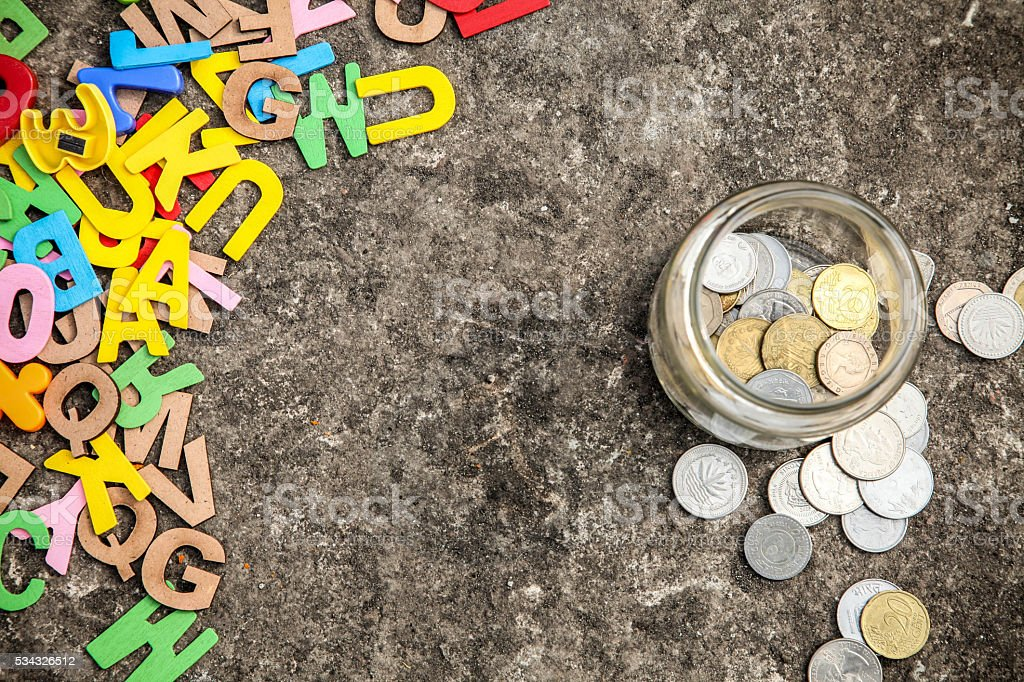 Colorful Letterpress alphabets and financial currency stock photo