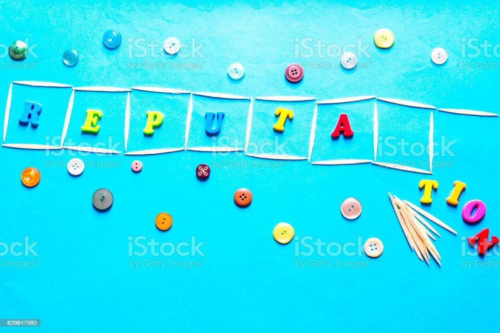 colorful letters and button reputation stock photo