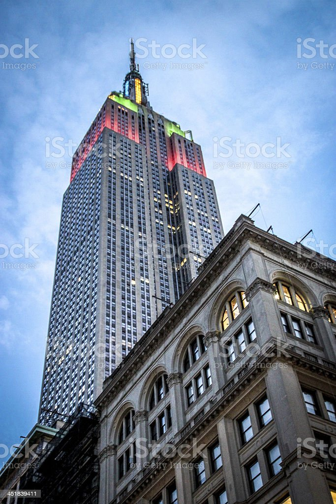 Colorful lights atop a tall building against blue cloudy sky stock photo