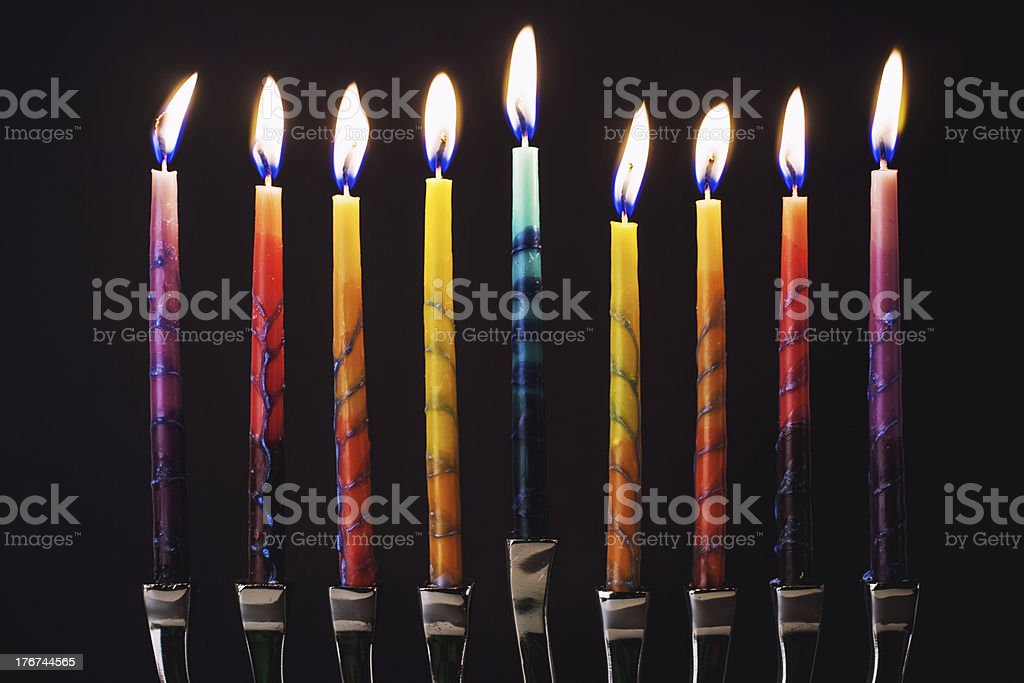 colorful lit menorah stock photo