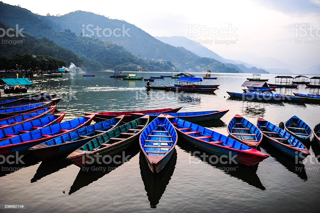 Colorful local boat in the beautiful lake,Nepal stock photo