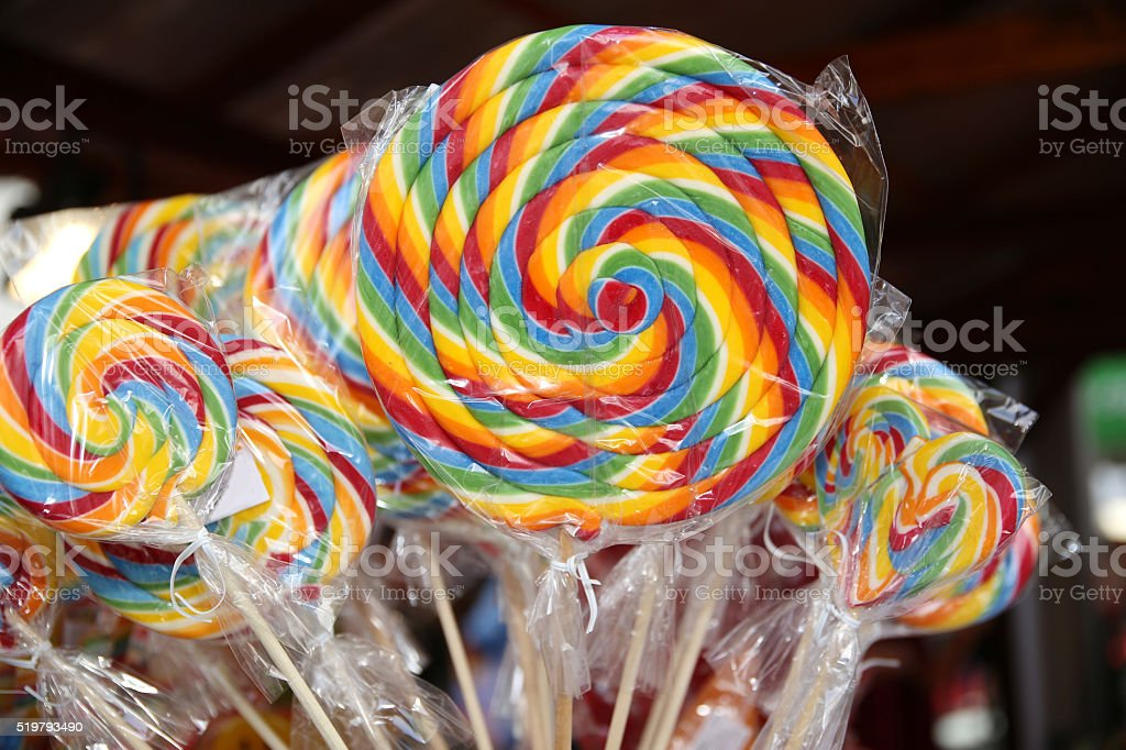 Colorful lollipops on street market as a background stock photo