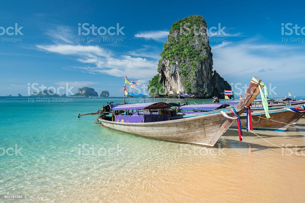 Colorful long tail boats at beautiful Ao Nang beach stock photo