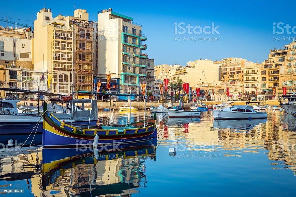 Colorful Luzzu fishing boats at Spinola bay - Malta stock photo