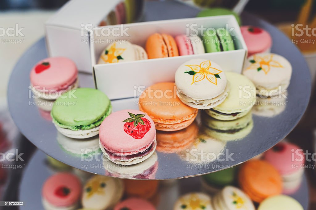 Colorful macaron cookies on bar for sale stock photo