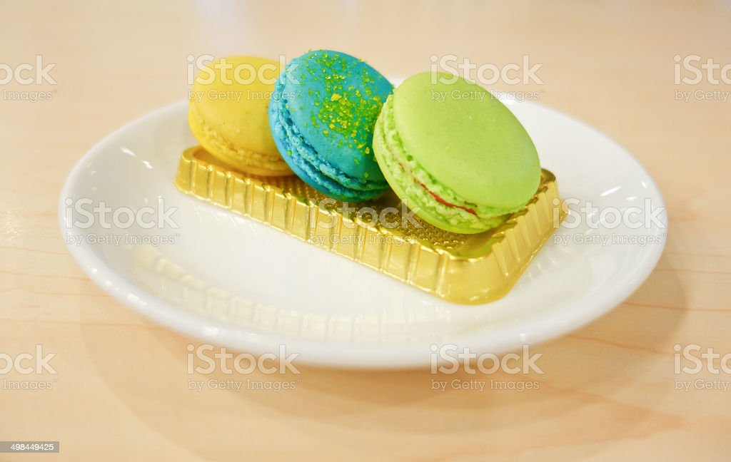 colorful macaron on white dish royalty-free stock photo