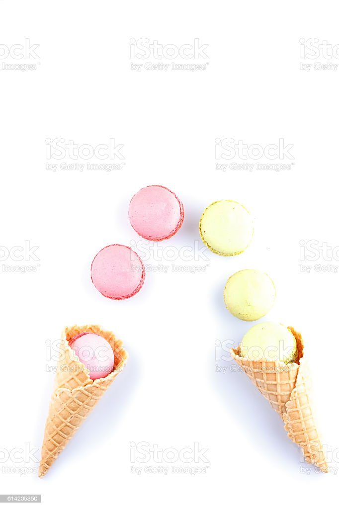 Colorful macaron pink color in ice cream cone of waffle stock photo