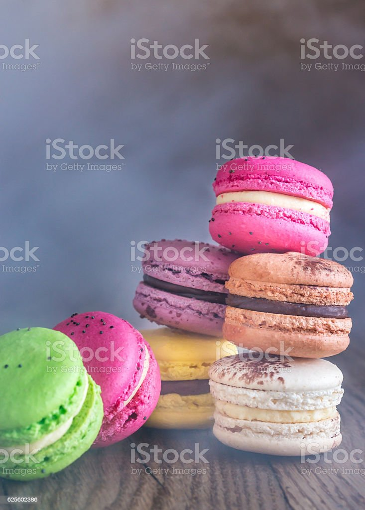 Colorful macarons on the wooden background stock photo