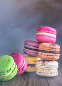 Colorful macarons on the wooden background