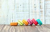 Colorful macarons on vintage pastel background. Macaron or Macar