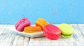 Colorful macarons on vintage pastel background. Macaron or Macar