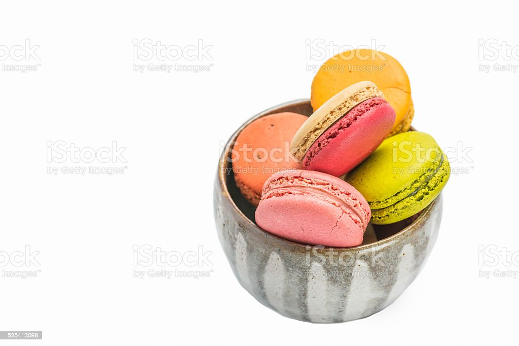 Colorful macaroons in a Japanese tea cup royalty-free stock photo
