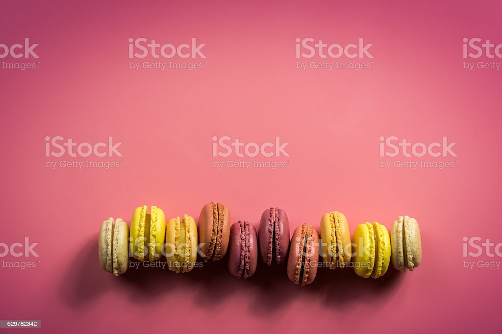 Colorful Macaroons on a Pink Background stock photo