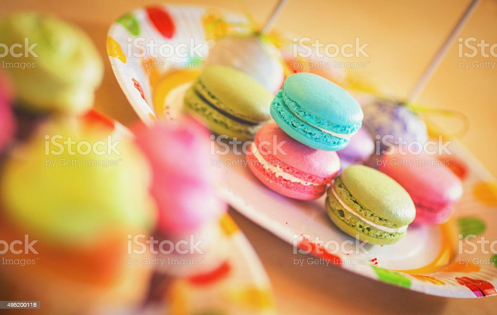 Colorful macaroons on a plate. stock photo