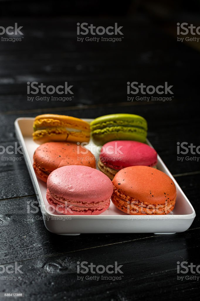 Colorful macaroons on wood background royalty-free stock photo