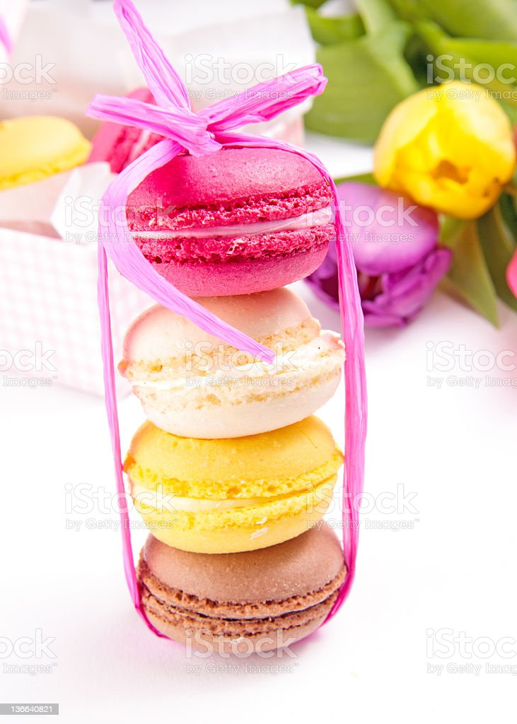 Colorful macaroons tied with ribbon royalty-free stock photo