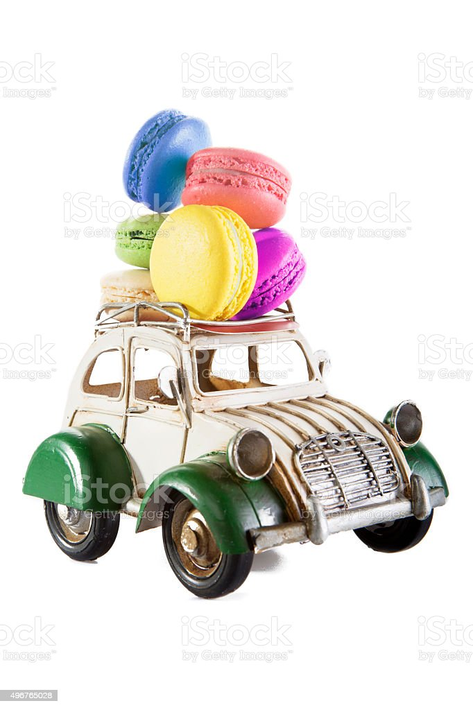 Colorful macaroons with toy car stock photo