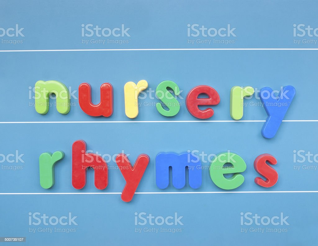 Colorful magnetic letters spelling nursery rhymes. stock photo