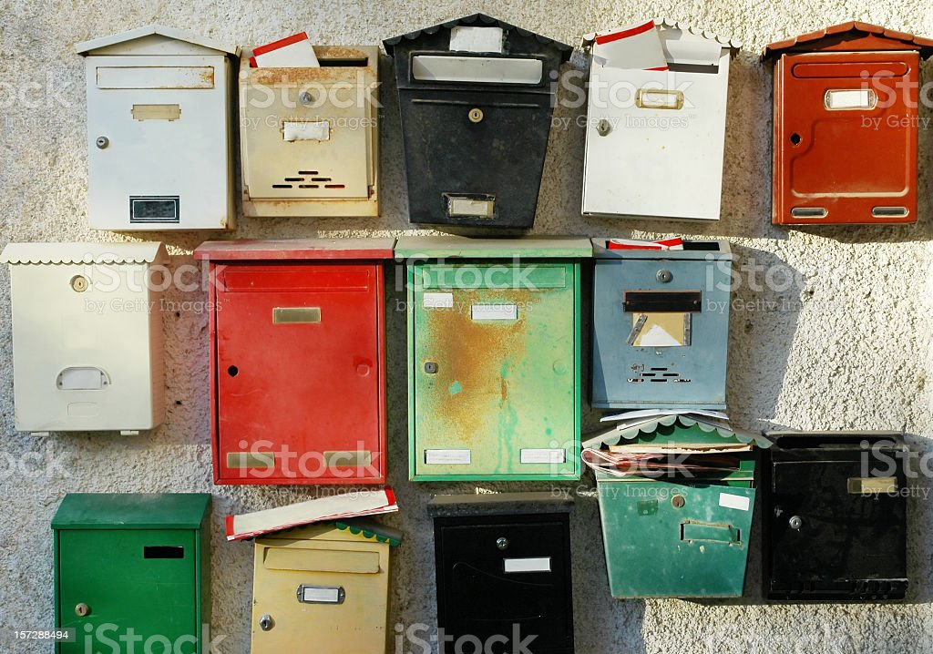 Colorful mailboxes at entrance of apartment buildings stock photo