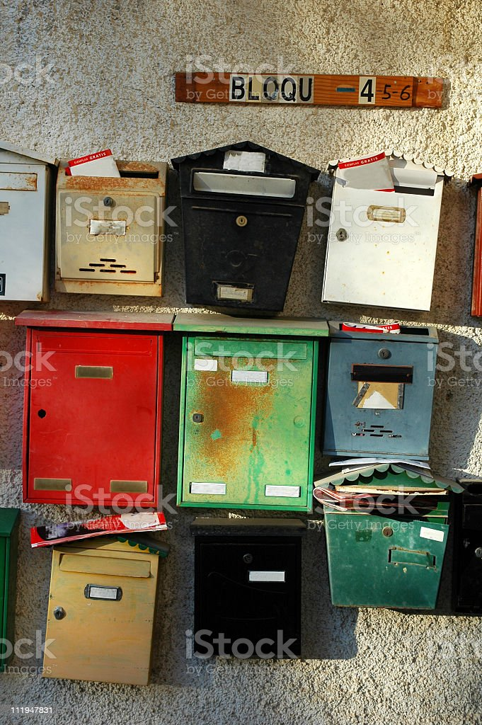 Colorful mailboxes at the entrance of a building with apartments. stock photo