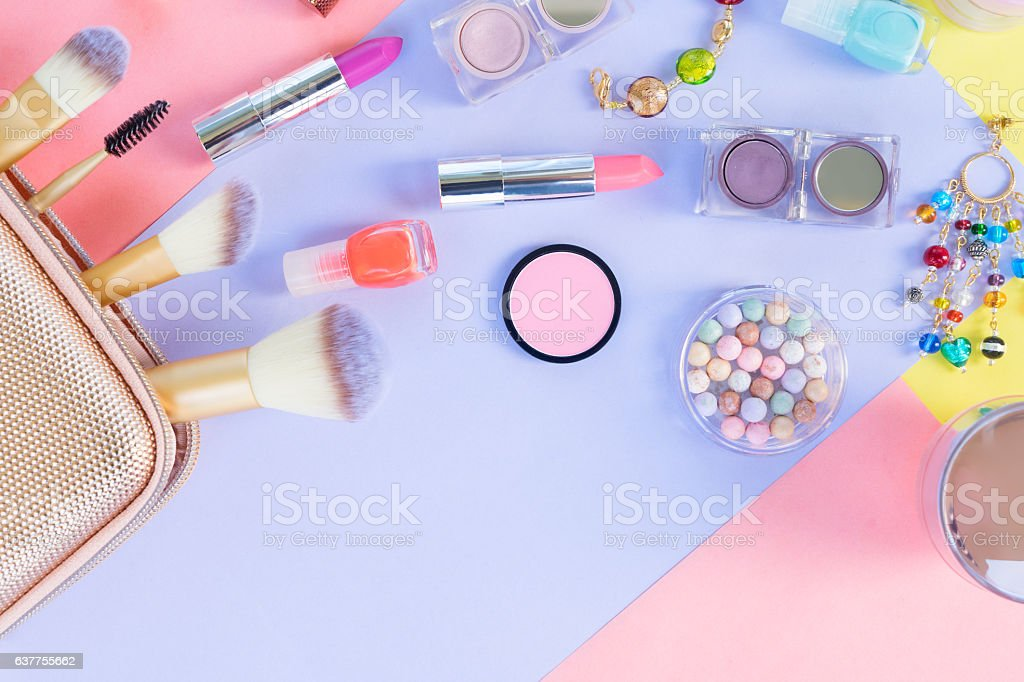 Colorful make up flat lay scene stock photo