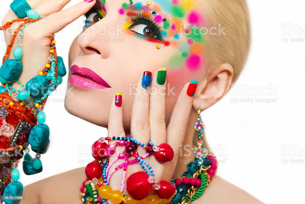 Colorful makeup and manicure. stock photo