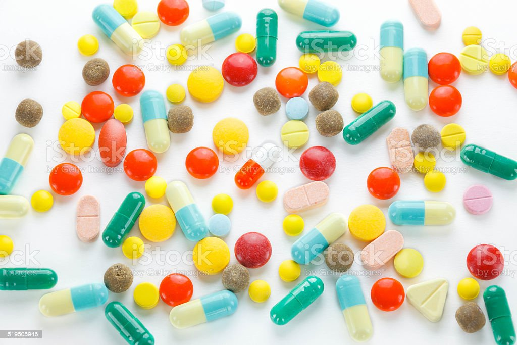Colorful many tablets ,pills and pill capsules on white backgrou stock photo