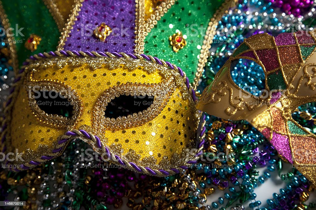 Colorful Mardi Gras carnival masks and beads stock photo