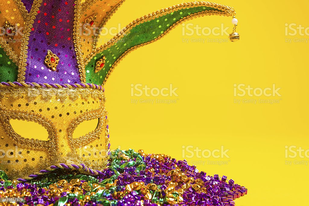 Colorful Mardi Gras or venetian mask on yellow stock photo