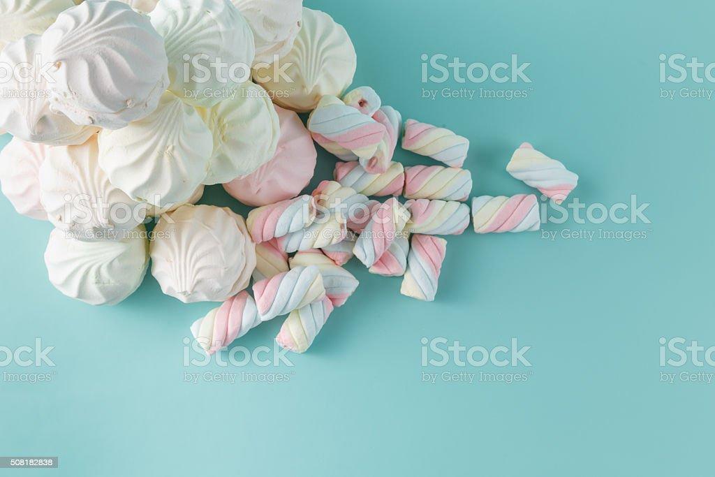 Colorful marshmallow hill on aquamarine background stock photo