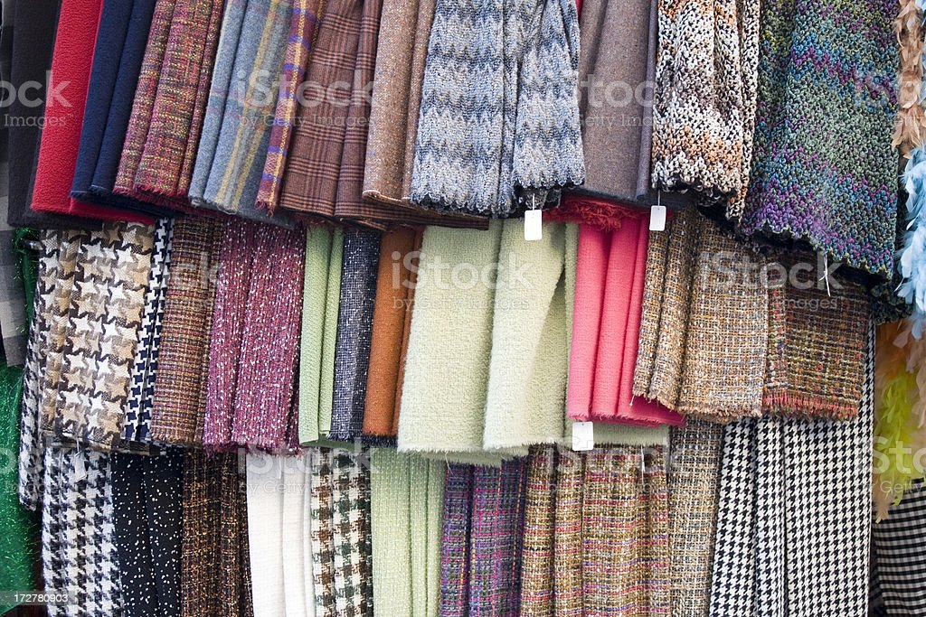 Colorful material at a French street market royalty-free stock photo