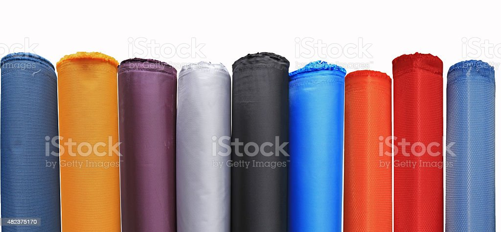 Colorful material fabric rolls in warehouse isolated on white background stock photo