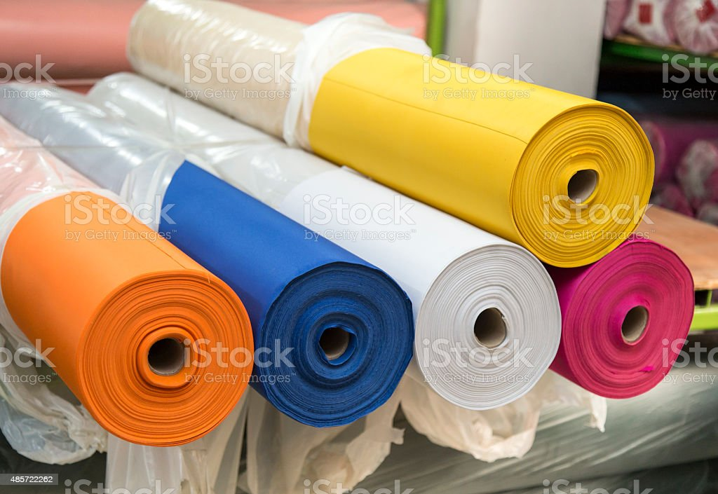 Colorful material fabric rolls - texture samples stock photo