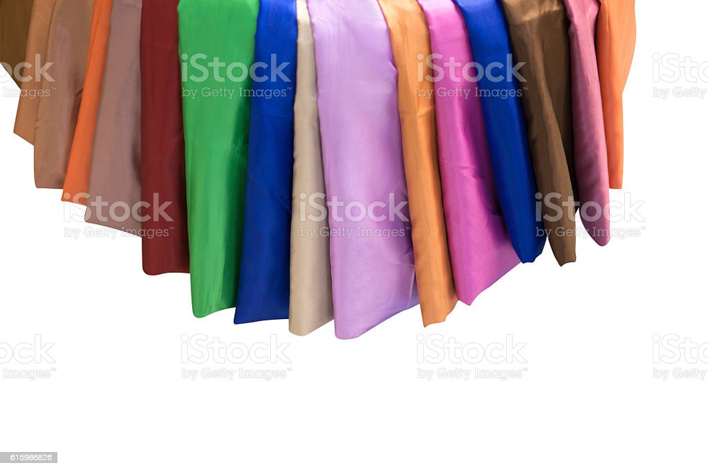 Colorful material of silk or satin fabric isolated. stock photo