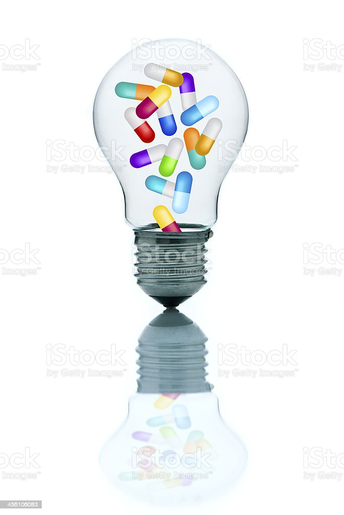 Colorful medicine pills in light bulb royalty-free stock photo