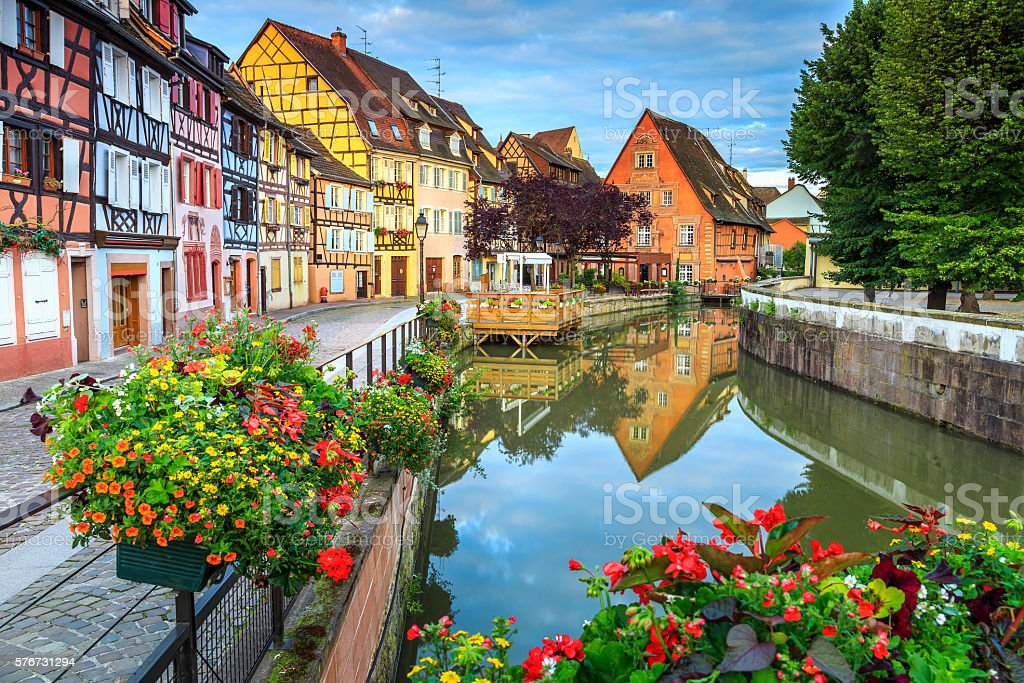 Colorful medieval half-timbered facades reflecting in water,Colmar,France stock photo
