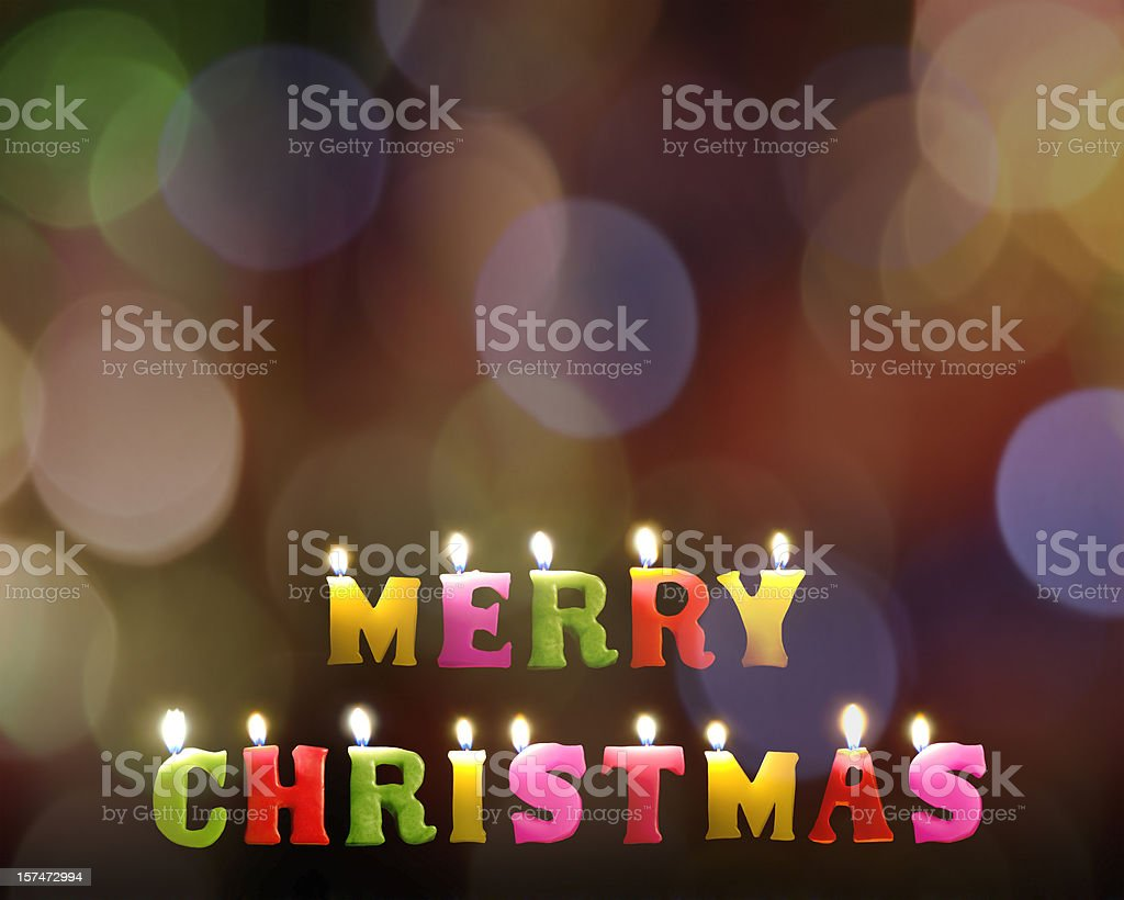 Colorful Merry Christmas candles on rainbow bokeh background royalty-free stock photo