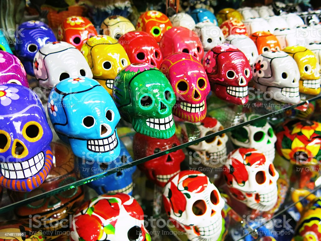 Colorful Mexican Skull Pottery Display on Shelves in Store stock photo