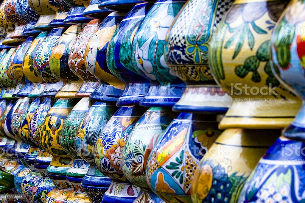 Colorful Mexican Vases Stacked in a Row stock photo