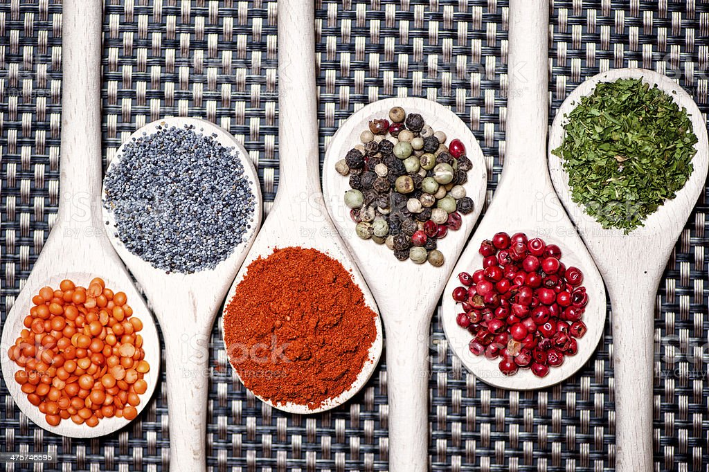 Colorful mix of assortment spices with bean seeds stock photo